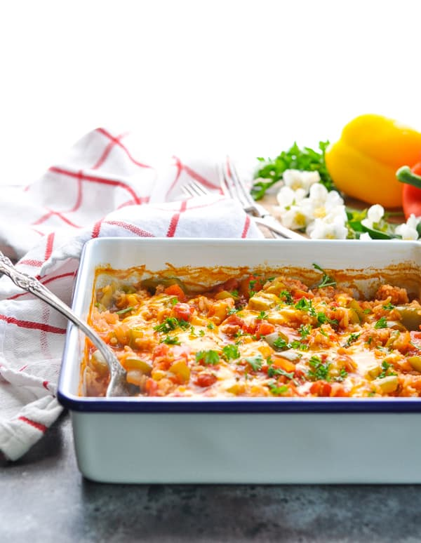 Use ground beef or ground turkey in this Dump and Bake Stuffed Bell Peppers Casserole!