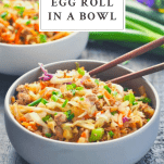 Front shot of a gray bowl full of egg roll in a bowl with text title box at the top