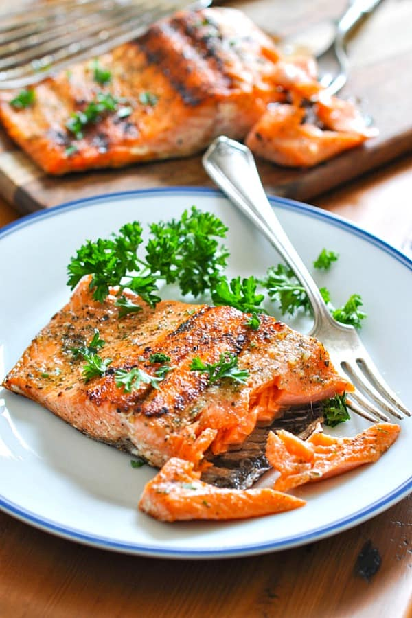 Piece of grilled salmon on a white plate
