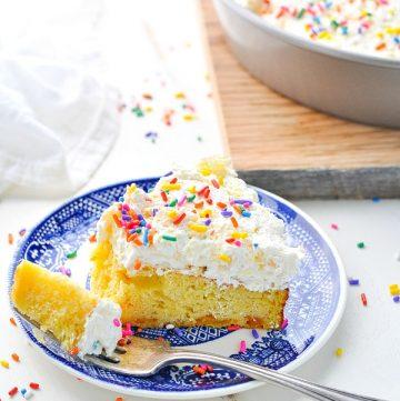 Bite of orange pineapple fluff cake on a fork