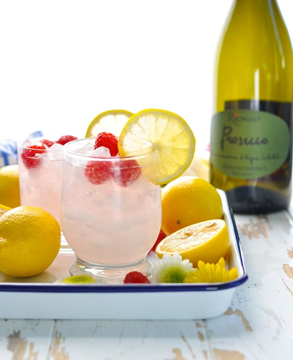 Tray of Italian Spritz Cocktails made with prosecco and pink lemonade