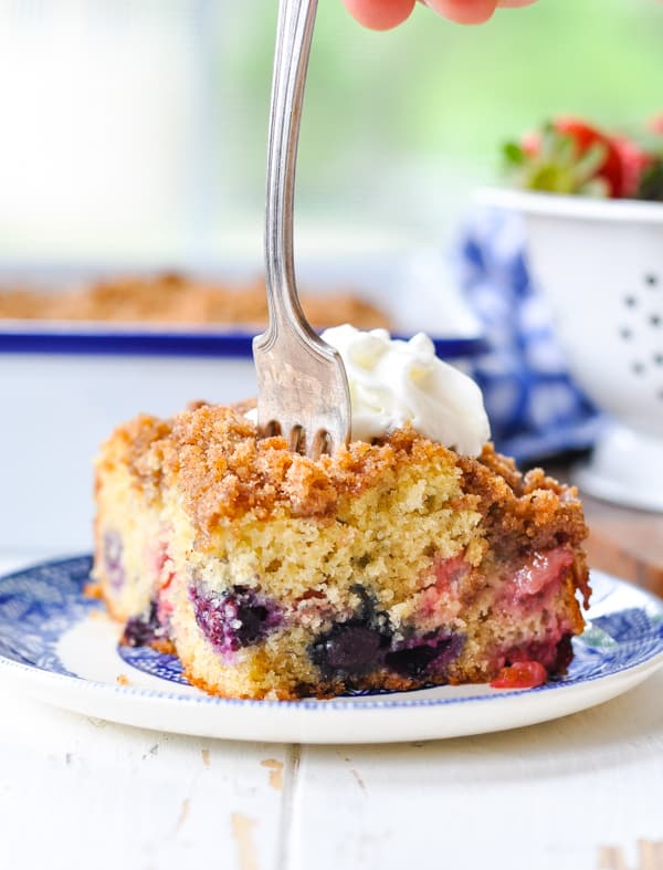 Fork in a slice of blueberry cake called Red White and Blueberry Buckle!