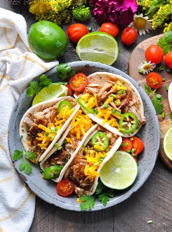 Overhead shot of a plate of easy and crispy slow cooker carnitas
