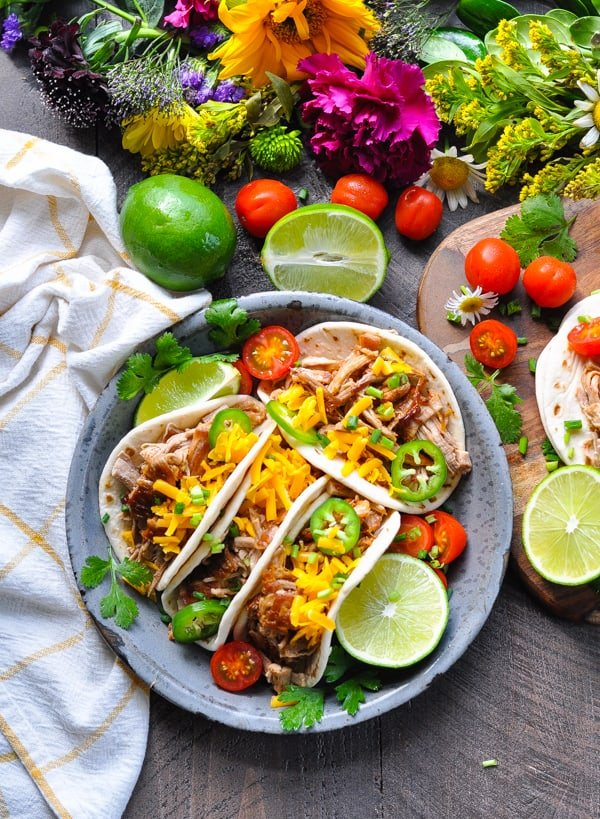 We love Mexican food like these healthy Slow Cooker Pork Carnitas!