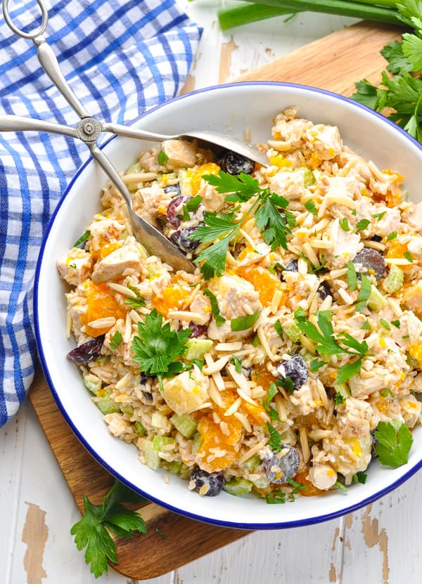This rice salad includes fresh fruit, slivered almonds, and marinated chicken for a healthy dinner or satisfying lunch!