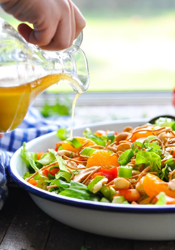 Top your Chinese Chicken Salad with plenty of salted cashews and this homemade orange sesame salad dressing