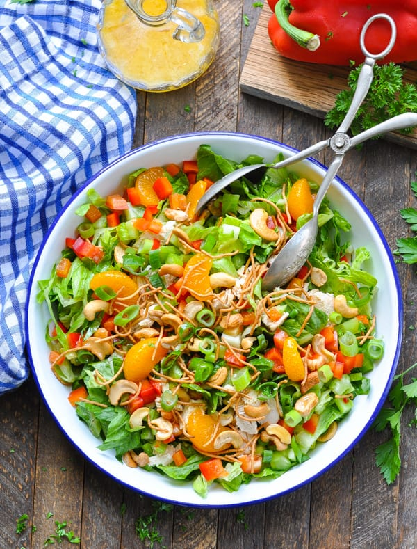 The seasoned mom bringing families together one easy meal at a time there is so much flavor and crunch in this chinese chicken salad with cashews making it the perfect warm weather lunch or dinner option forumfinder Choice Image