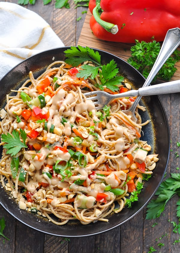 A bowl of Peanut Sesame Noodles are an easy and healthy dinner recipe to serve warm or cold.