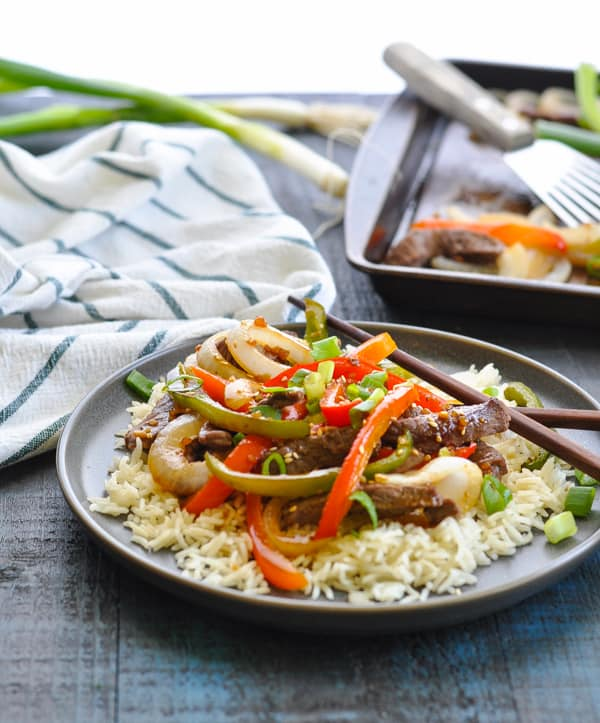 Dinner comes together in 10 minutes with this easy recipe for a healthy Chinese Pepper Steak!
