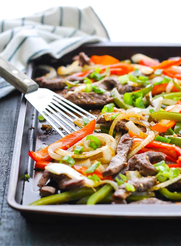 This dump and bake chinese pepper steak is an easy sheet pan dinner that's also healthy!