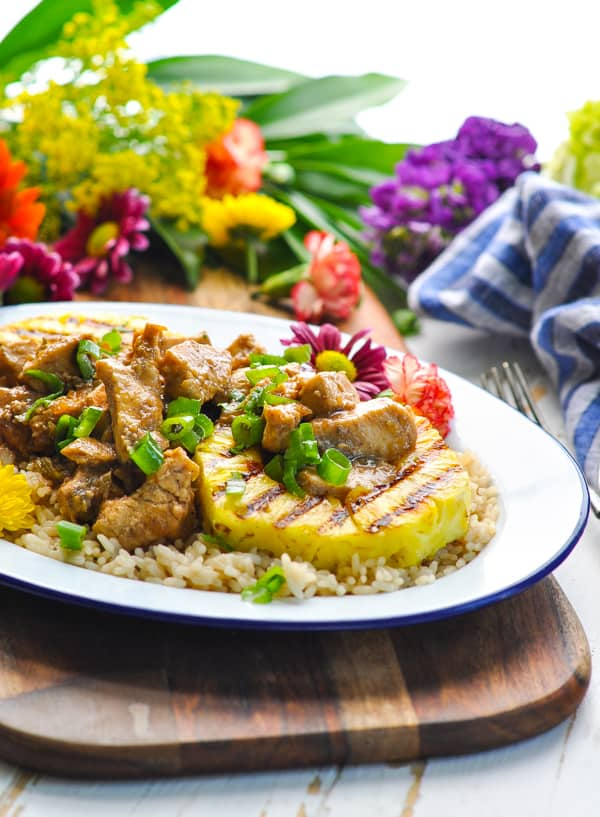 Serve this Dump and Bake Jerk Chicken over rice with grilled pineapple
