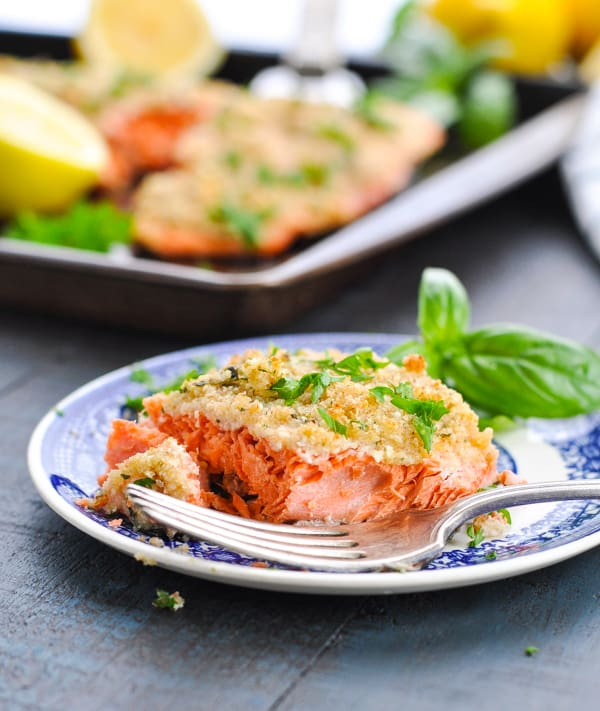 A piece of baked salmon fillet with parmesan crust.