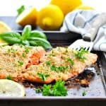 This baked salmon fillet uses Parmesan and fresh basil for a healthy dinner!