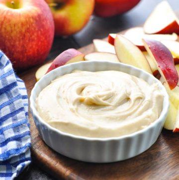 Cream cheese apple dip in a white bowl