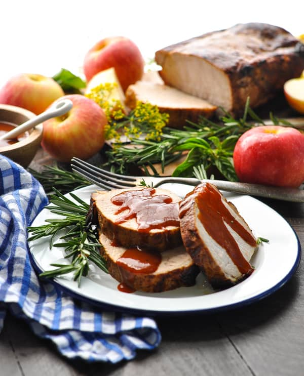 Sliced oven roasted pork loin drizzled with barbecue sauce