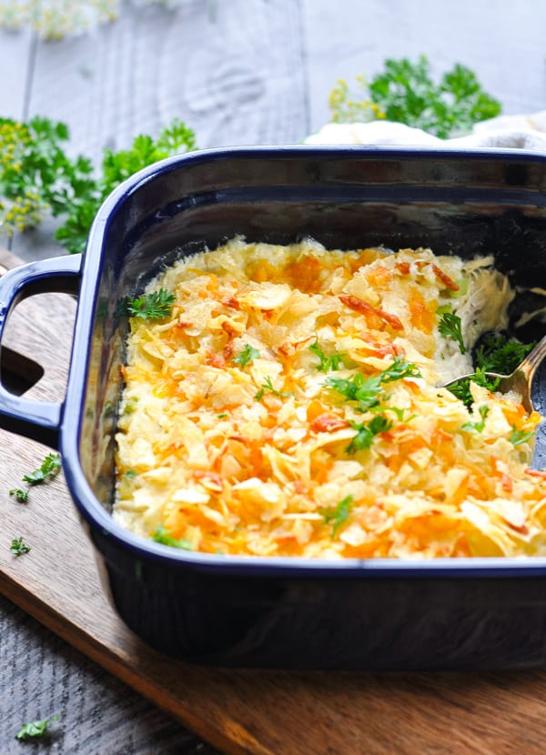 Hot Chicken salad casserole in a navy blue baking dish