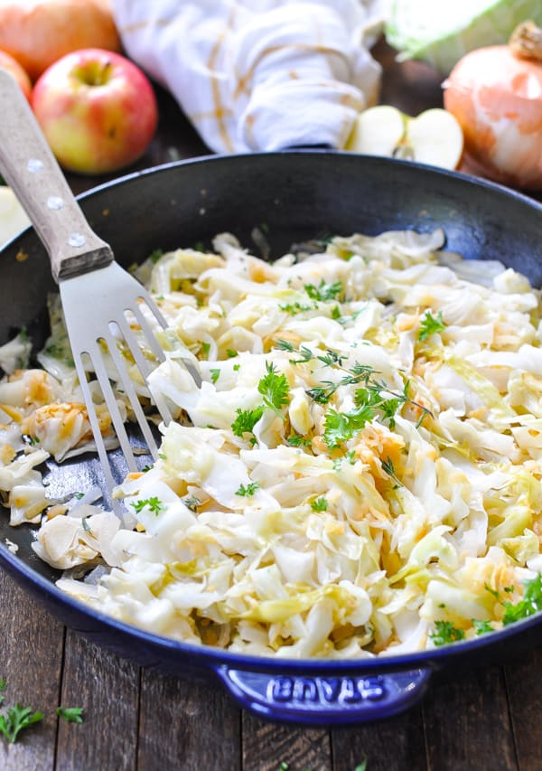 Fried cabbage in a skillet with spatula