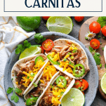 Overhead shot of a plate of crispy slow cooker carnitas with text title box at top