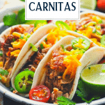 Close up side shot of slow cooker pork carnitas on a plate with text title overlay