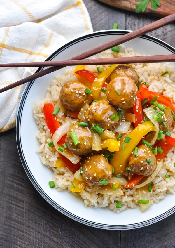 Asian meatballs with peppers and onions over rice