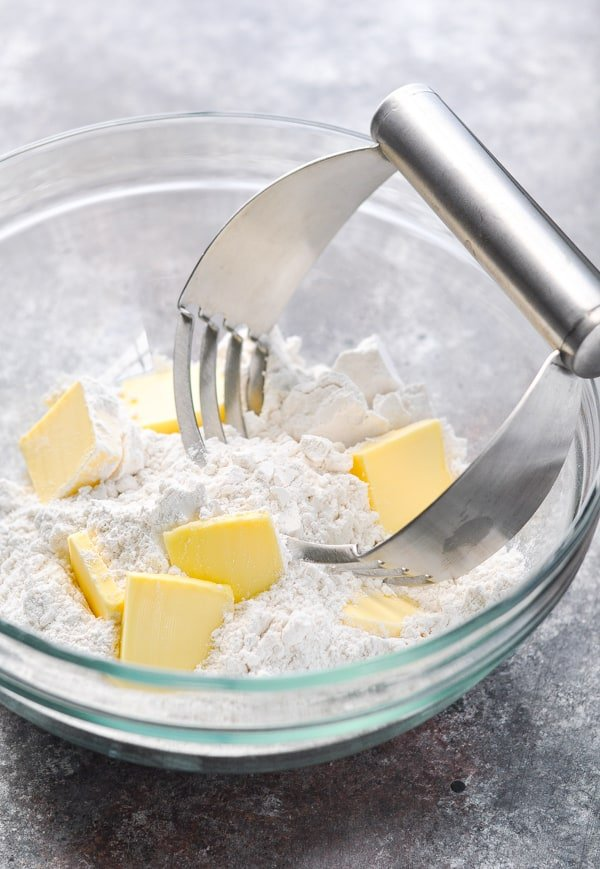 self rising flour and butter in a bowl