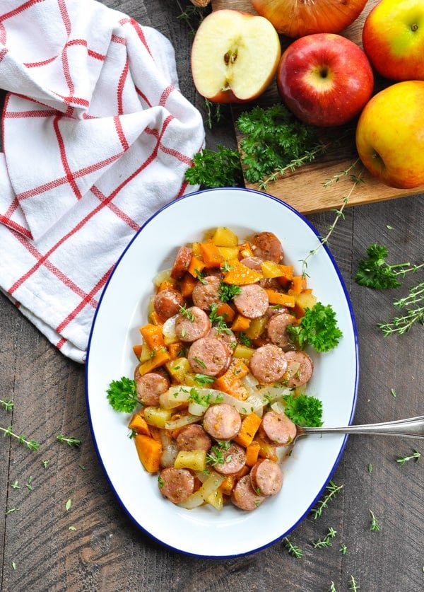 Overhead image of baked chicken sausage and sweet potatoes casserole on a serving dish