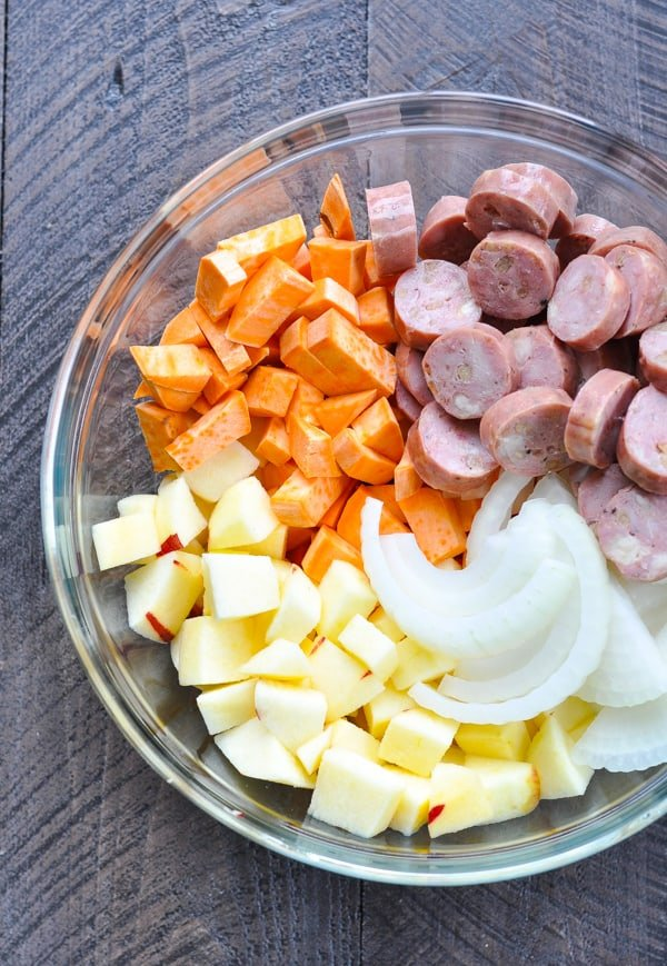 Chopped ingredients for baked sweet potatoes in a glass bowl