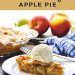 Front shot of a slice of homemade apple pie with text title at the top