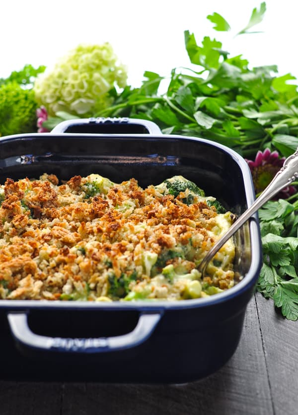 An easy healthy broccoli casserole in a blue baking dish