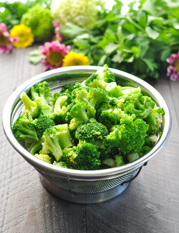Steamed broccoli florets in colander
