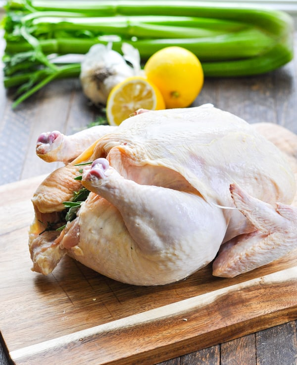 Image result for raw whole chicken and vegetables in skillet