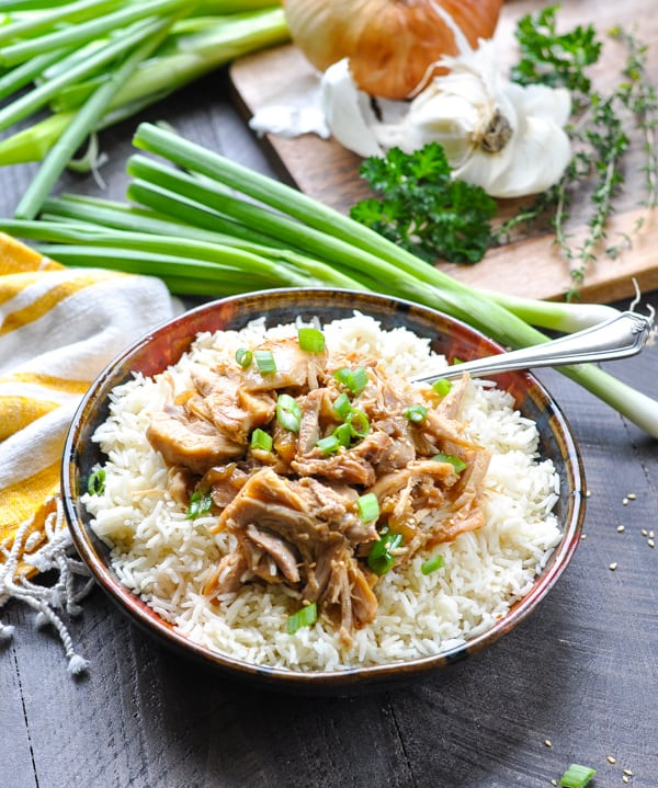 Instant Pot Garlic Sesame Chicken in a bowl of rice