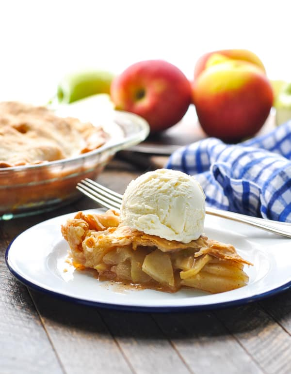 Slice of easy apple pie topped with vanilla ice cream