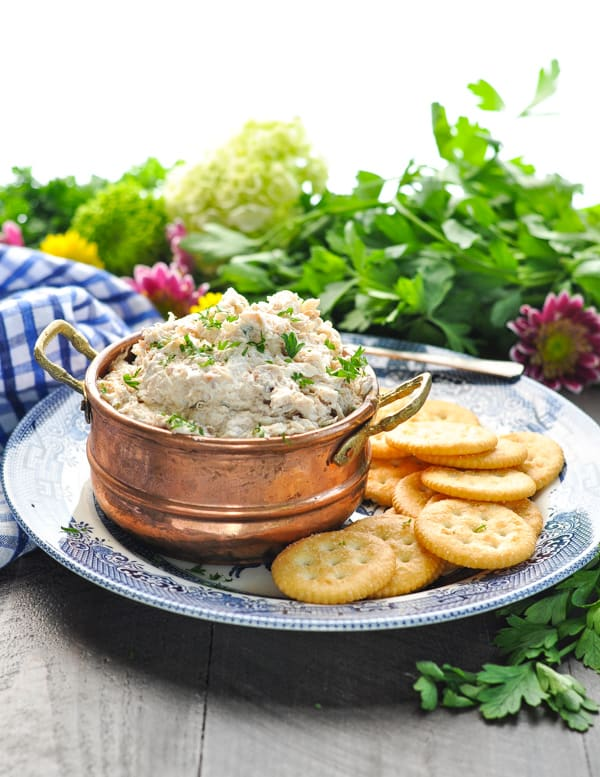 Blue and white plate with hot crab dip and crackers