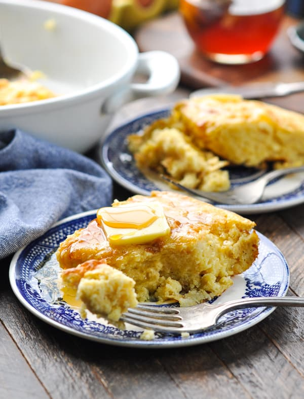 Spoon bread topped with butter and honey