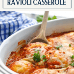 Front shot of a wooden spoon in ravioli casserole with text title box at top