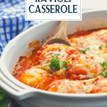 Side shot of ravioli casserole with wooden spoon and text title overlay