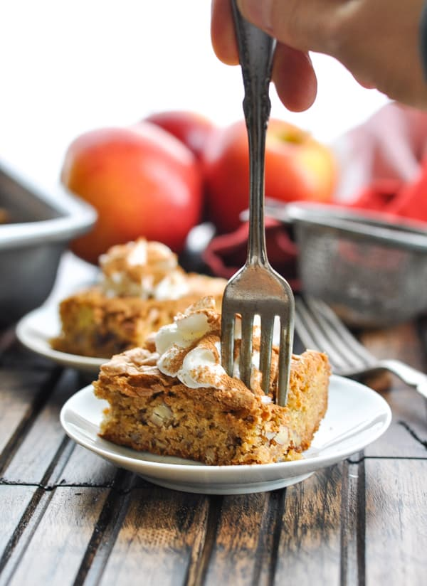Apple Pecan Date Bar on a plate with fork