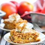 Apple Cinnamon Date Bar on a plate with whipped cream and cinnamon