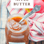 Spoon in a jar of homemade apple butter with text title at the top