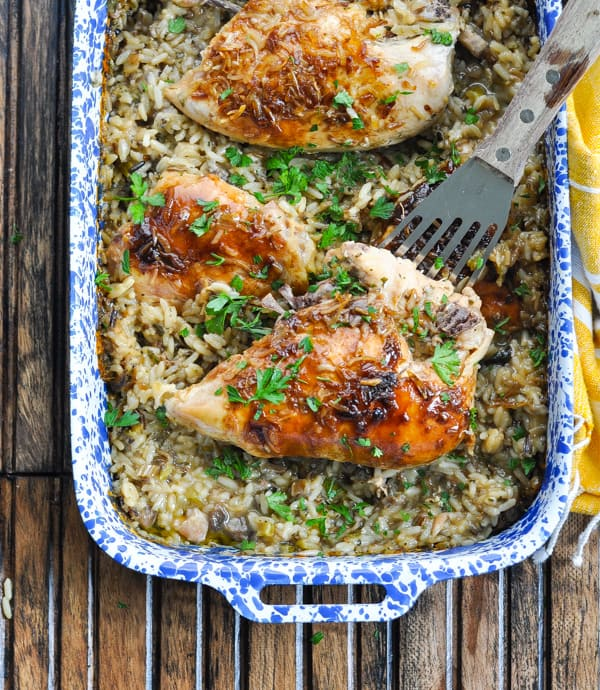 Overhead image of baked chicken wild rice casserole with spatula