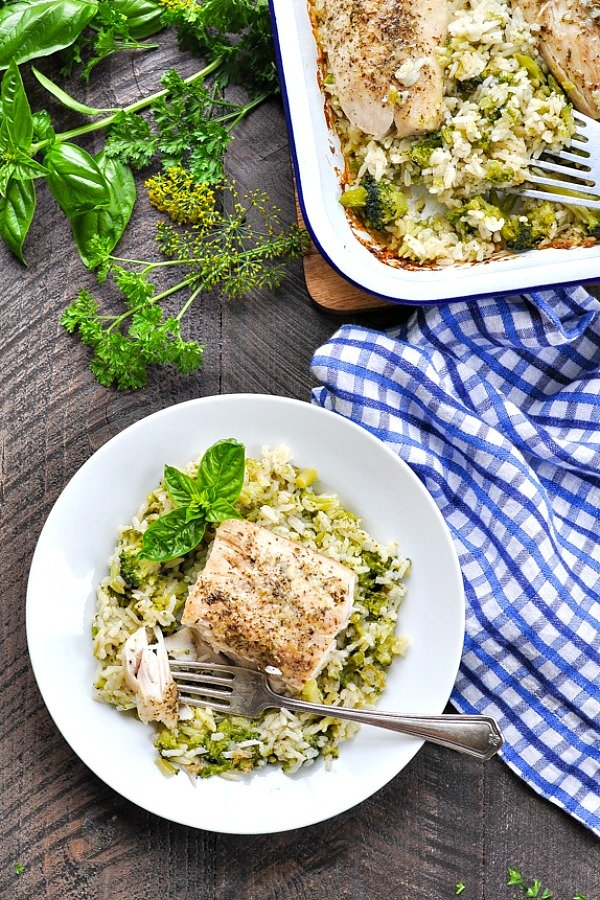 Overhead shot of Italian Fish with broccoli and rice on a white plate