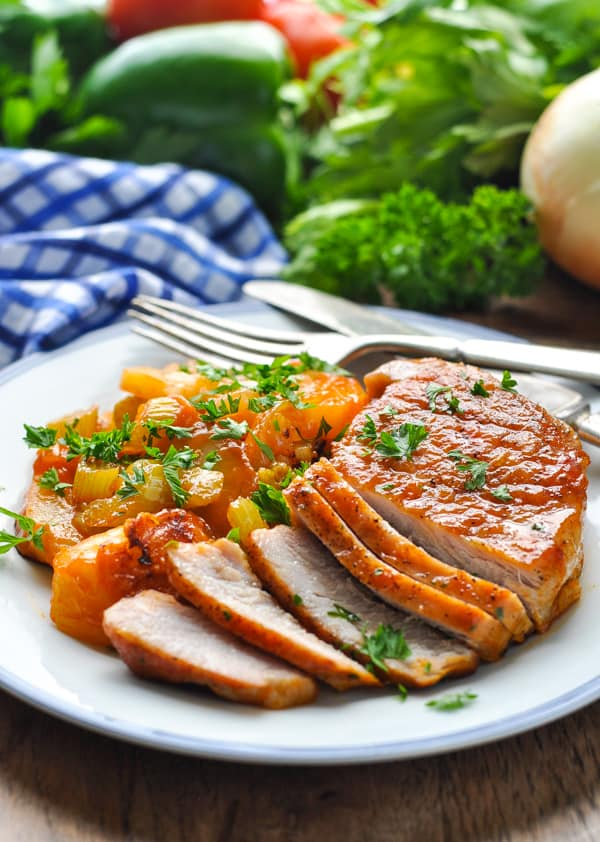 Pork chops on a plate with vegetables