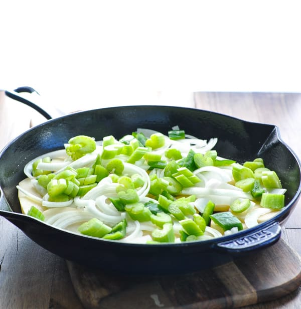 Raw vegetables in a cast iron skillet
