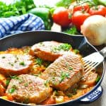 Boneless pork chops in a skillet with text overlay