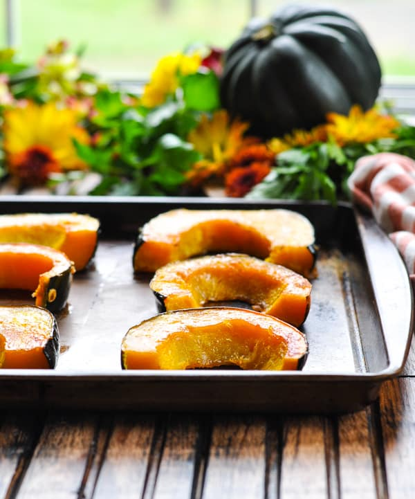 Healthy Brown Sugar Roasted Acorn Squash on a baking sheet