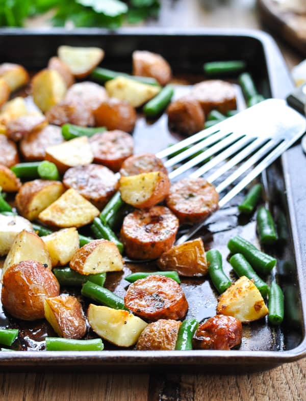 Baking sheet with Italian sausage, potatoes, and green beans