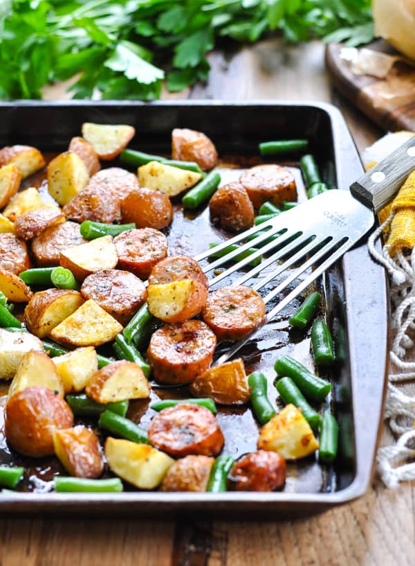 Baking sheet with Italian sausage, potatoes and green beans