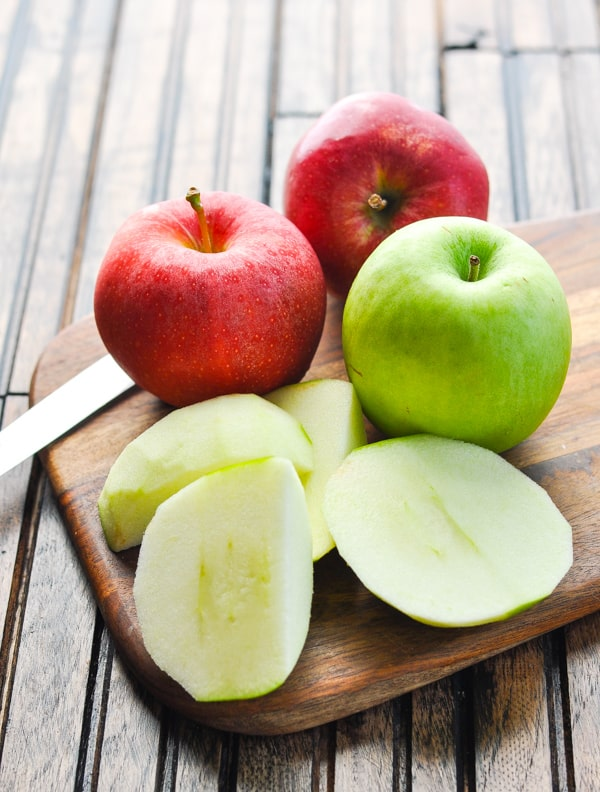 Peeled apple on a cutting board for apple butter