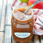 Jar of homemade apple butter with text title overlay
